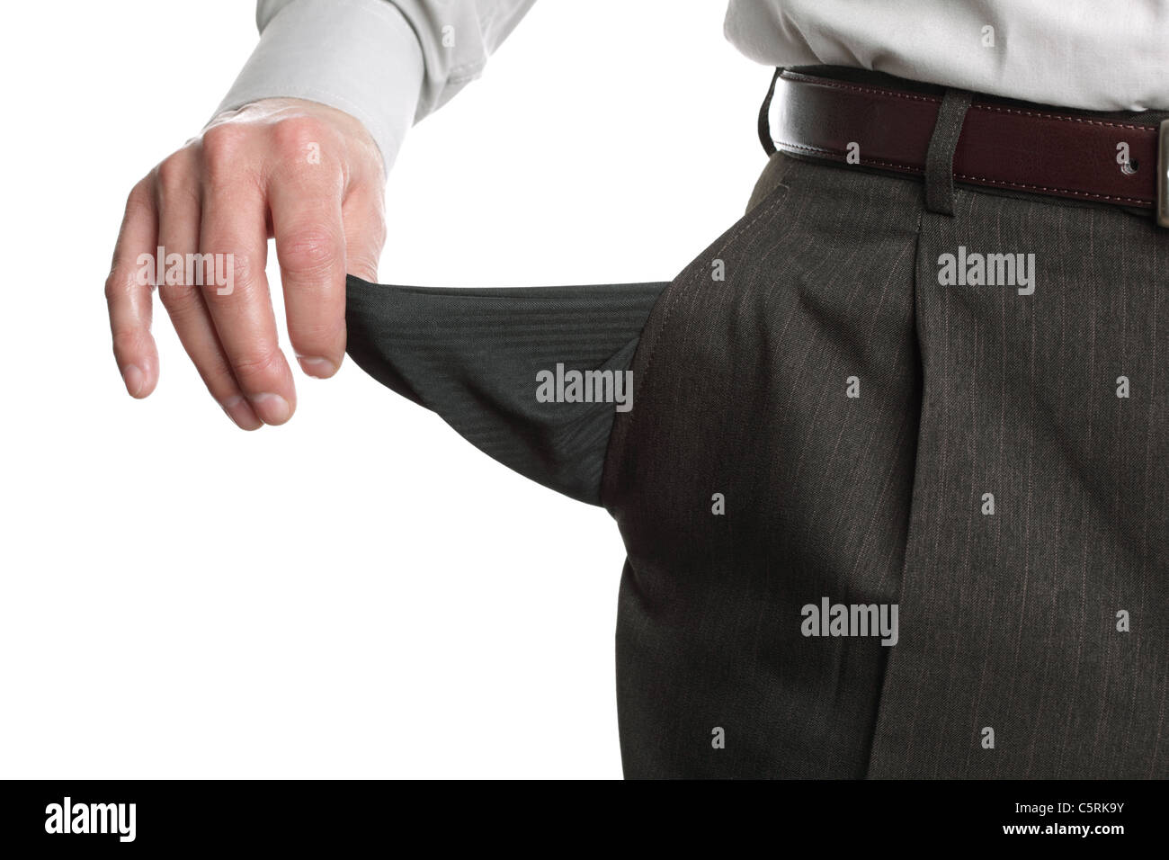 Bankrupt man showing empty pocket - Stock Image