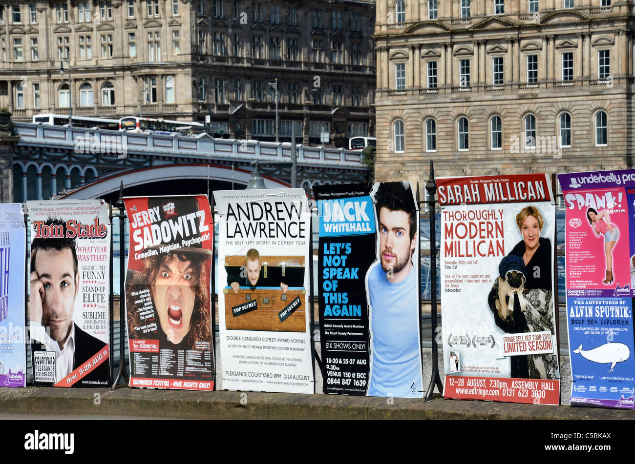Posters advertising shows on the 2011 Edinburgh Festival Fringe against the backdrop of the New Town. - Stock Image