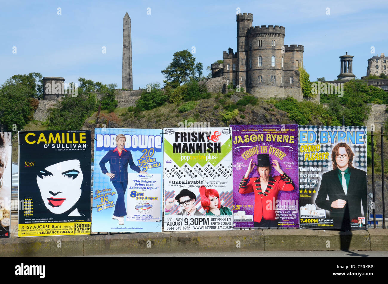 Posters advertising Edinburgh Fringe shows against the backdrop of Calton Hill. - Stock Image