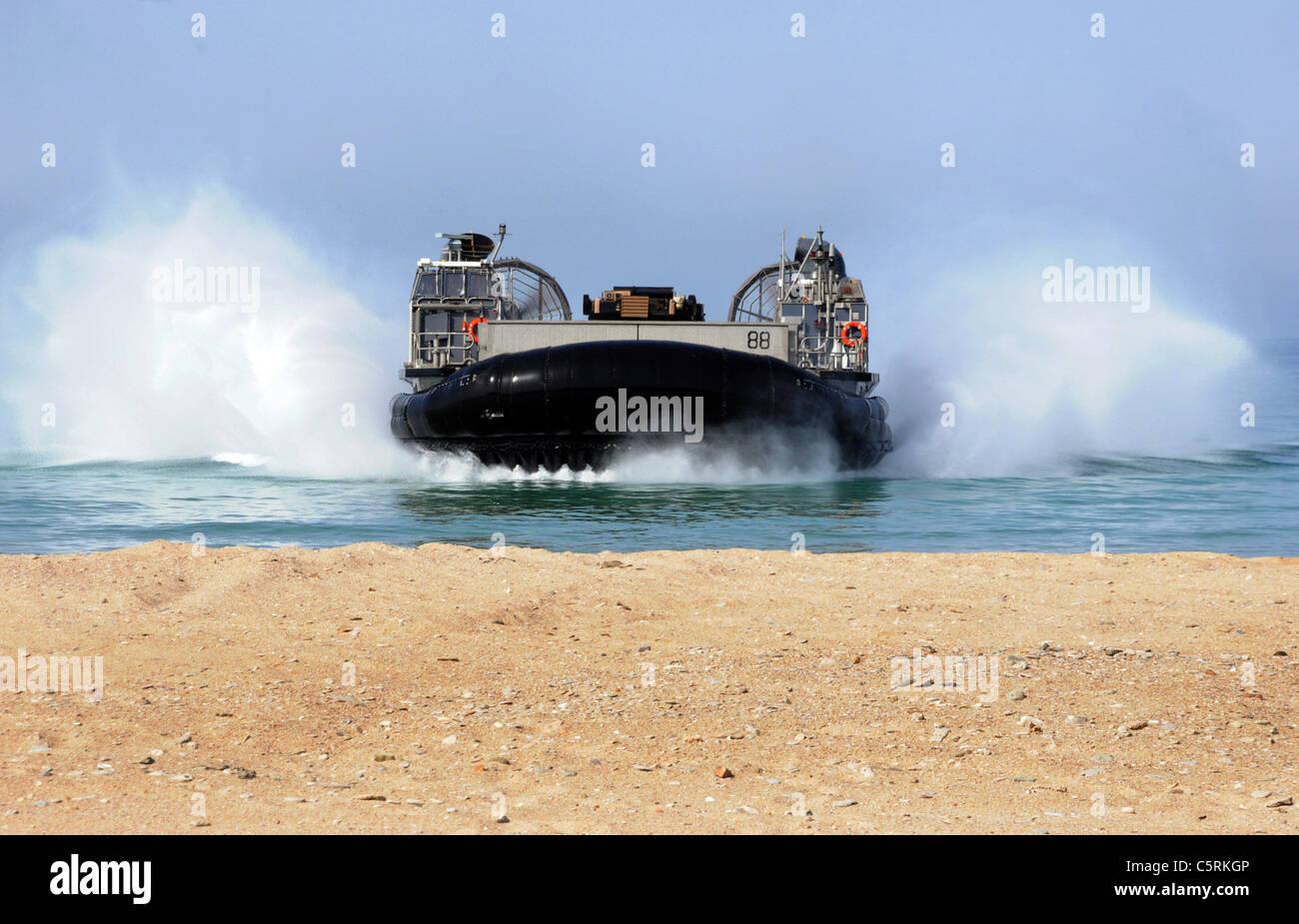 amphibious vehicle landing on beach Stock Photo