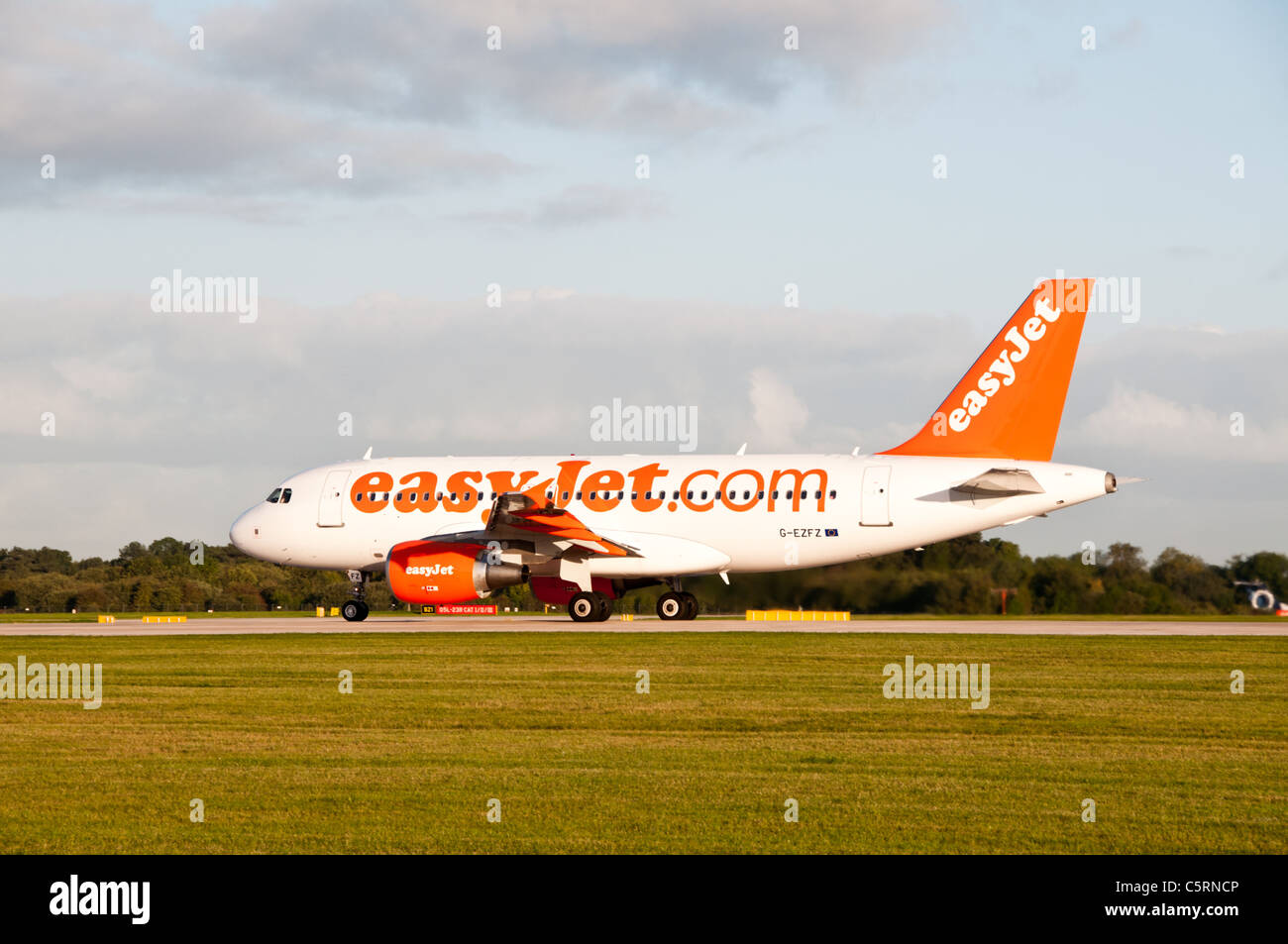 an easyJet airbus A319 on the runway at Manchester airport - Stock Image