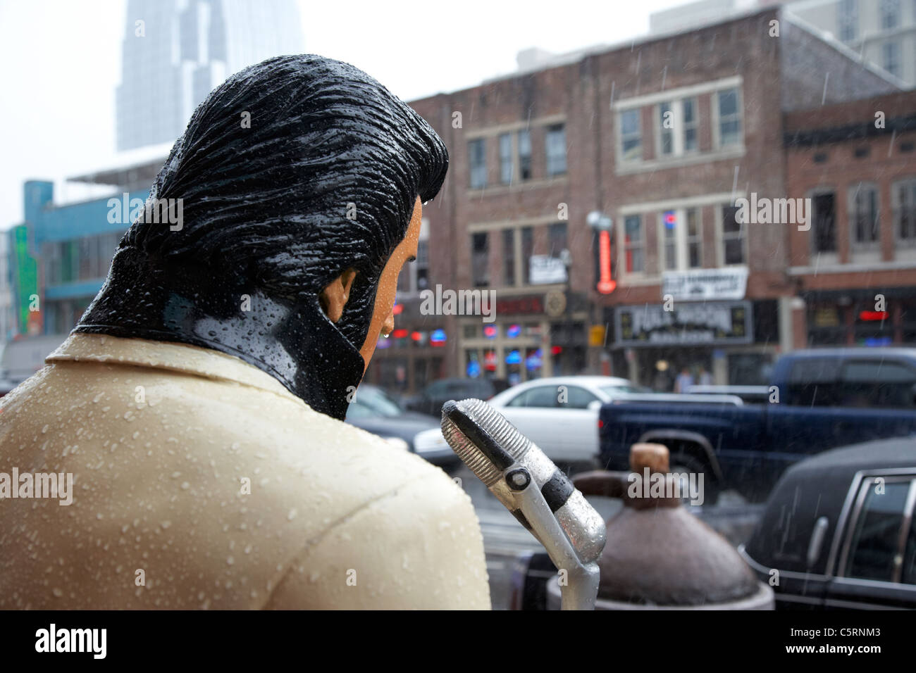 elvis statue in heavy rain downtown broadway Nashville Tennessee USA - Stock Image