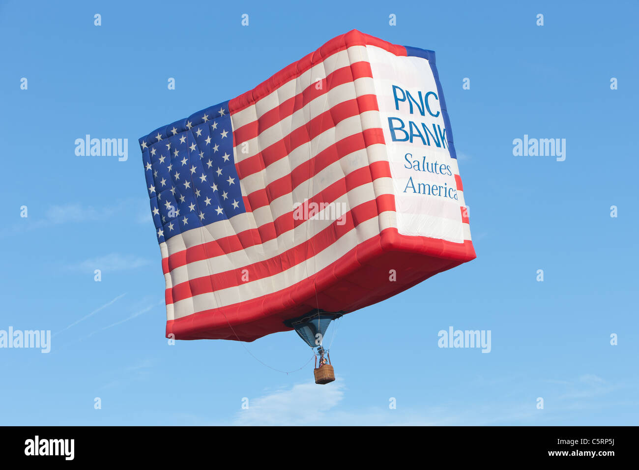 The PNC Bank hot air balloon rises during a morning balloon