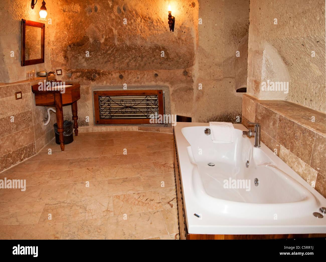 renovation of a bathroom with bathtub, marble floor, limestone walls ...