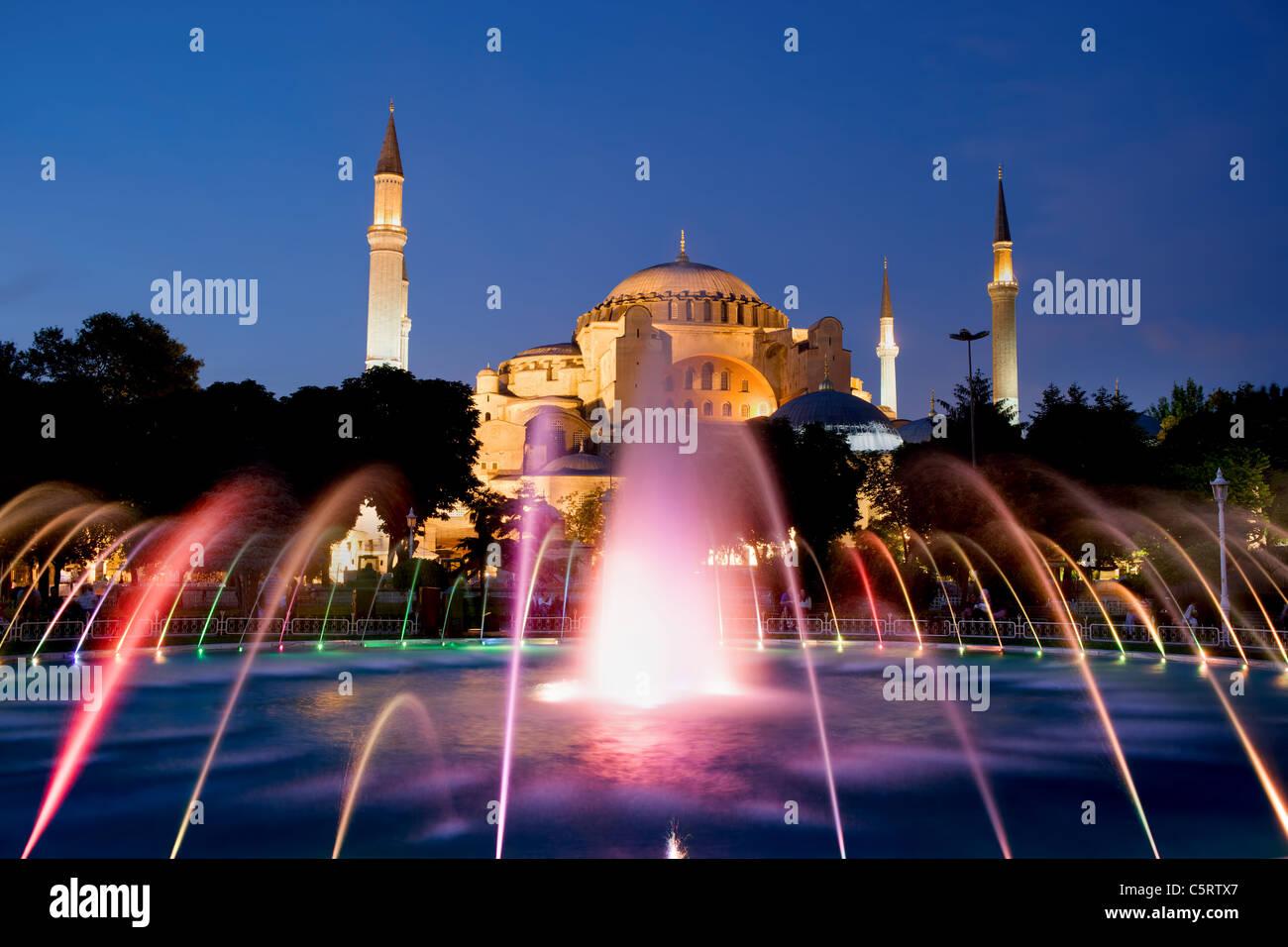 The Hagia Sophia Byzantine architecture and fountain illuminated at dusk, famous historic landmark in Istanbul, Stock Photo