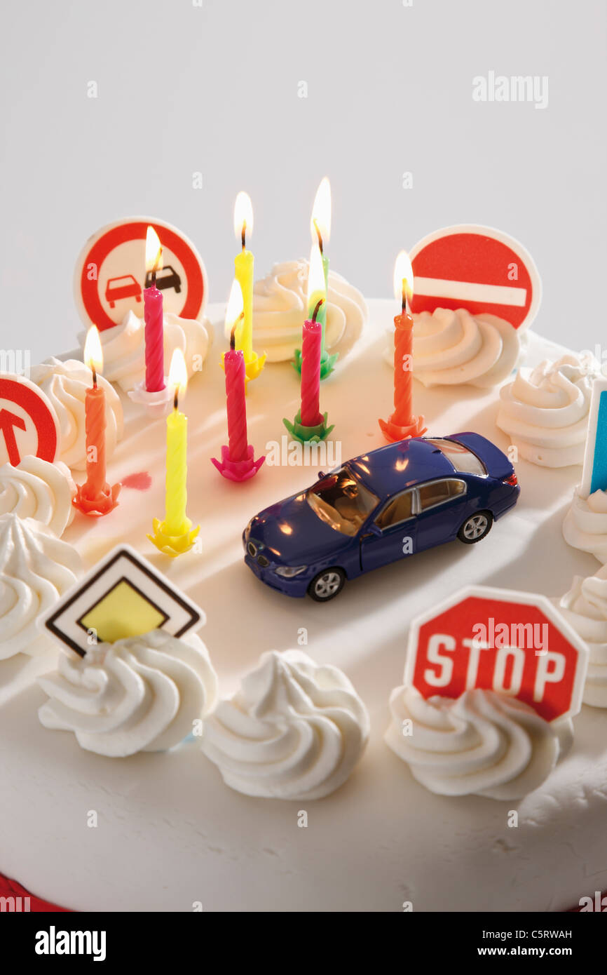 Fancy cake with road signs and toy car, elevated view - Stock Image