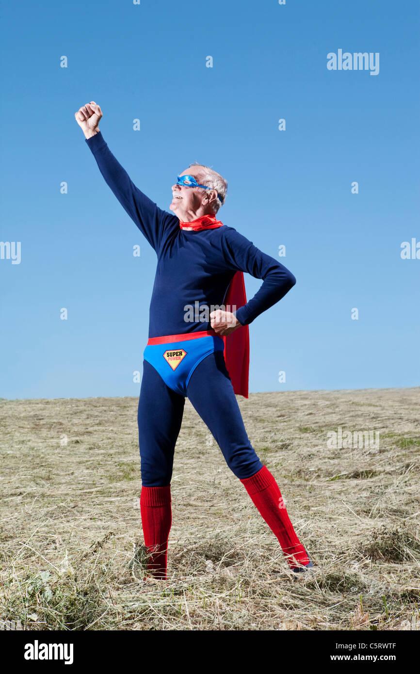Austria, Burgenland, Senior man in superman's costume - Stock Image