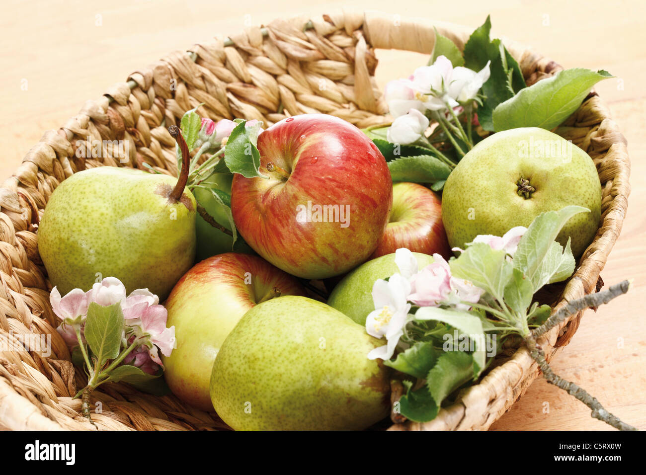 Apples, Pears and blossoms in basket, elevated view - Stock Image