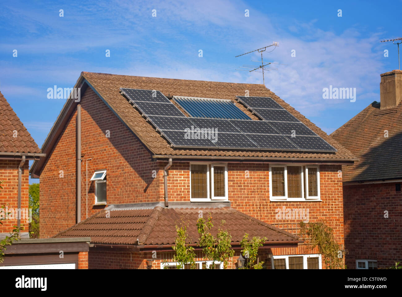 Solar panels on house - Stock Image