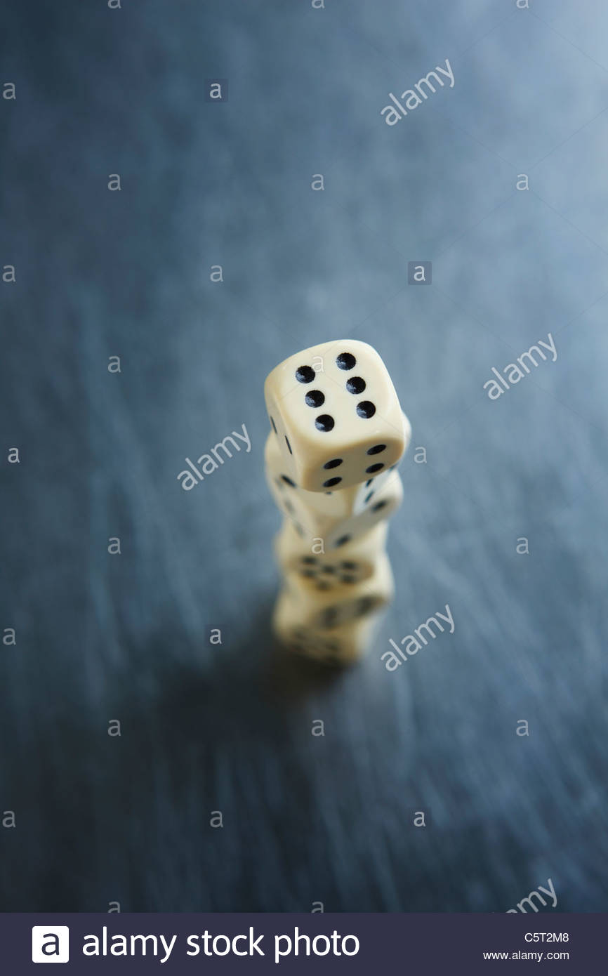 Stacked dice, elevated view, close-up - Stock Image