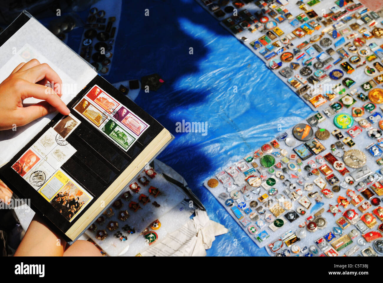 Stamps and badges for sale in street market, Crimea, Ukraine - Stock Image