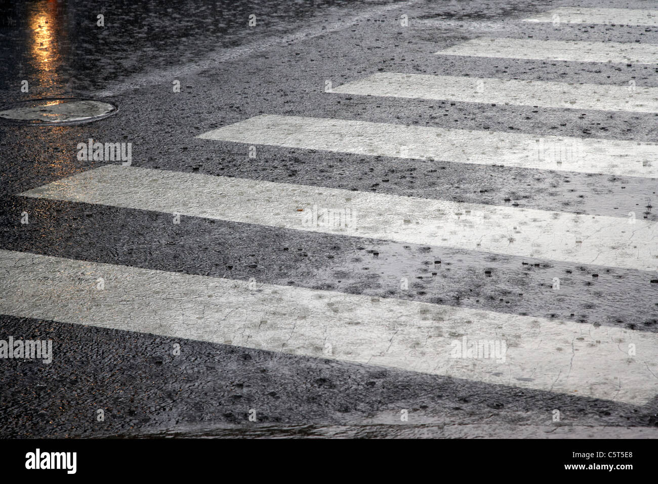 crosswalk in heavy rain downtown broadway Nashville Tennessee USA - Stock Image