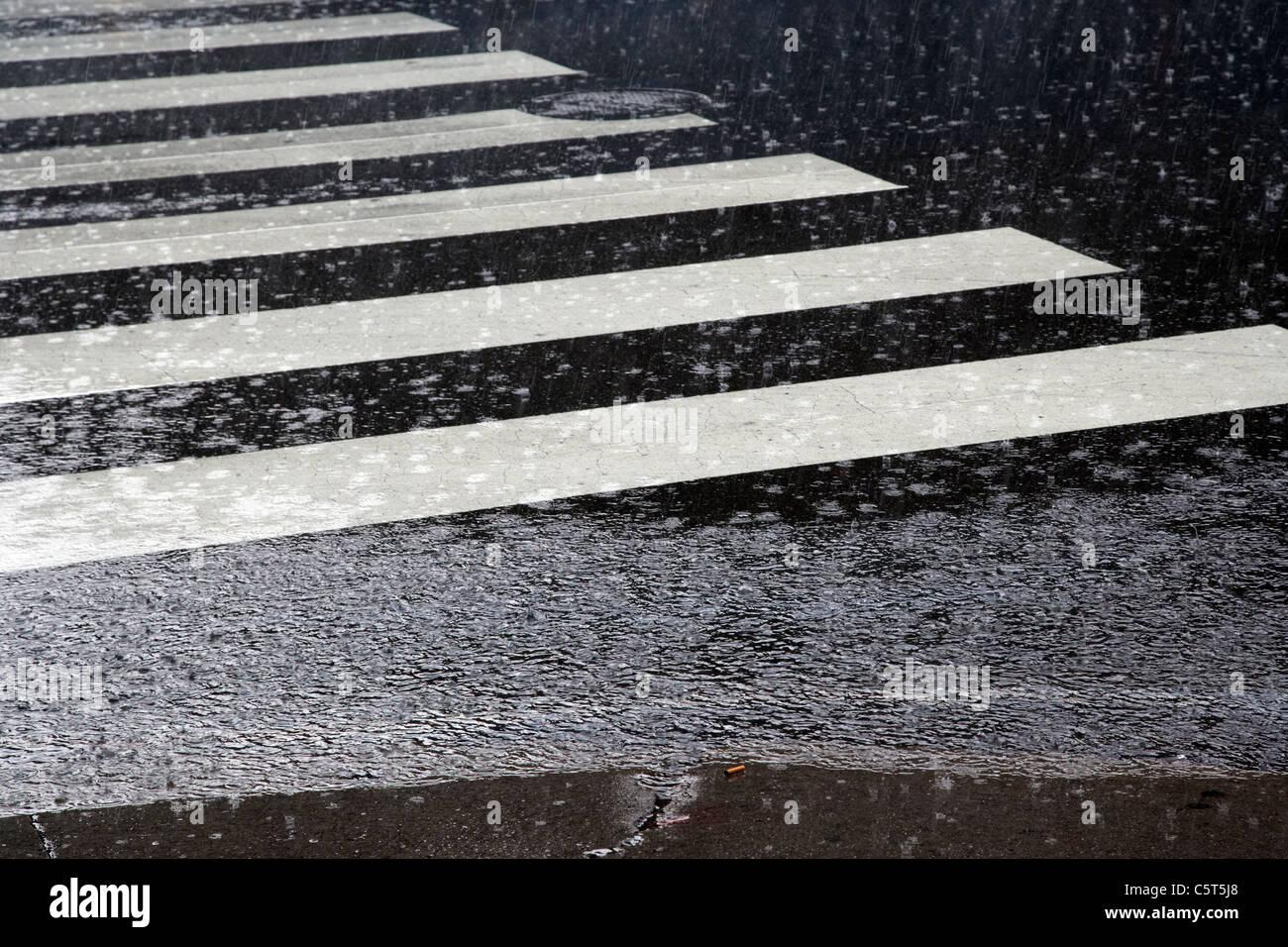 crosswalk in heavy rain downtown broadway Nashville Tennessee USA - Stock Image