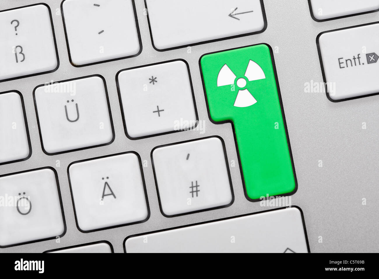 Close up of computer keys with atom symbol on green key Stock Photo