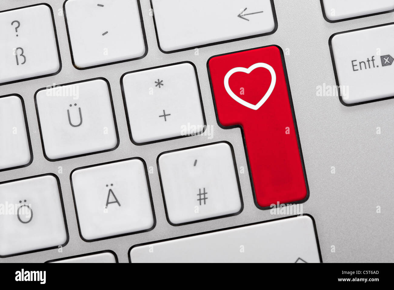 Close Up Of Computer Keys With Heart Symbol On Red Key Stock Photo