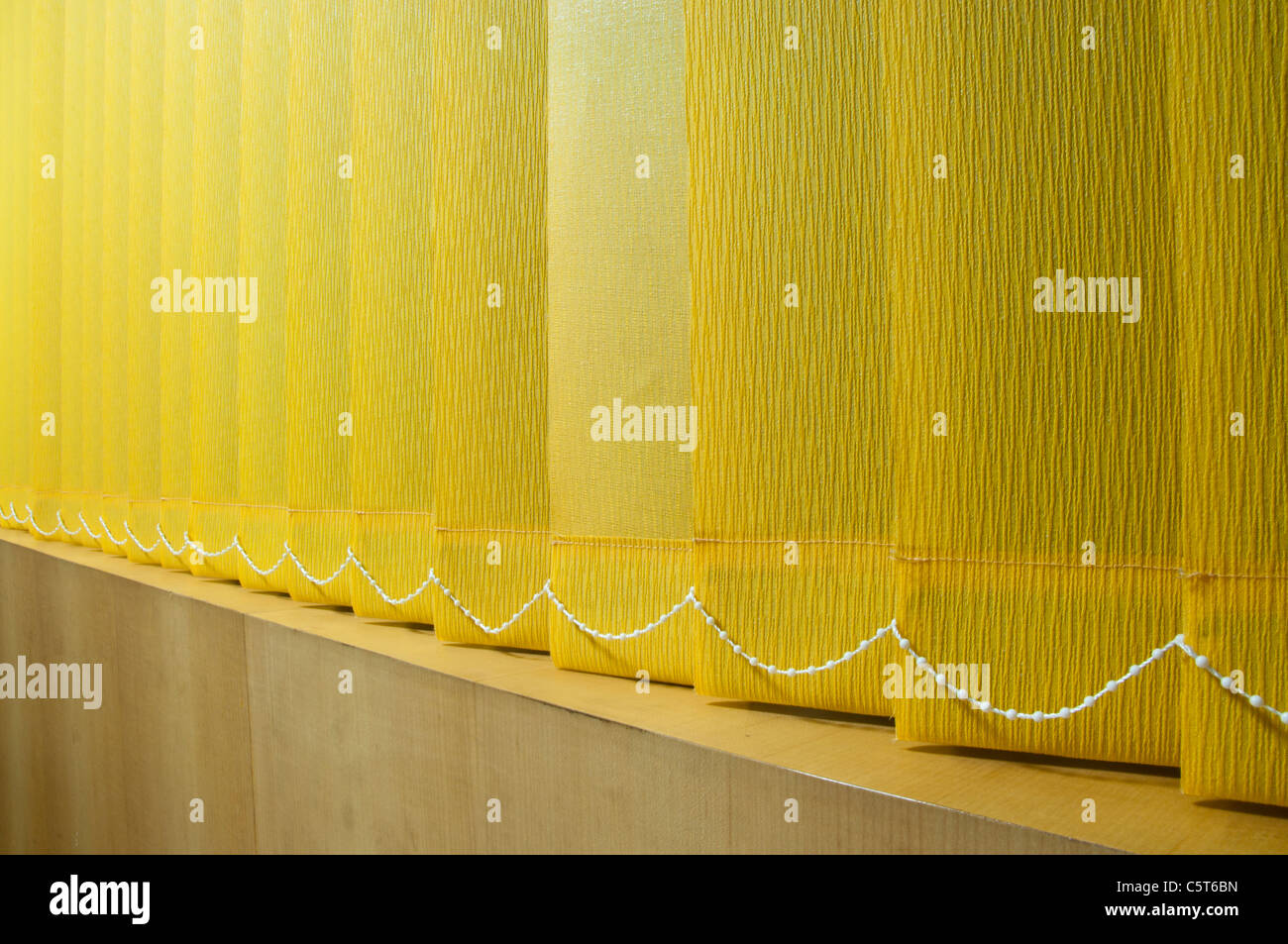 Closed venetian blinds in office - Stock Image