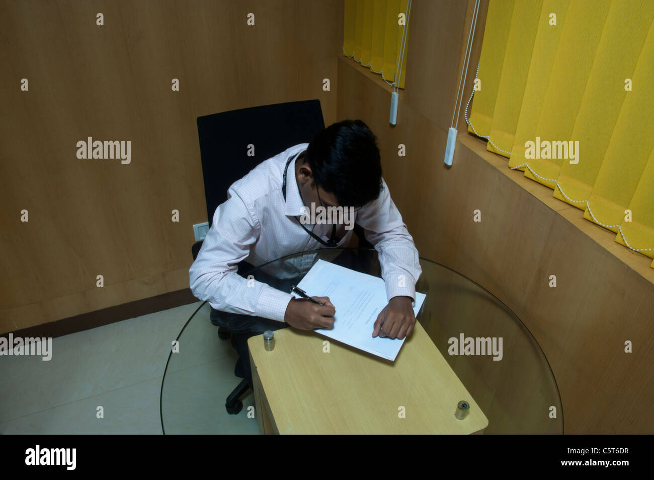 Young Indian Man At Work In Office Cabin   Stock Image