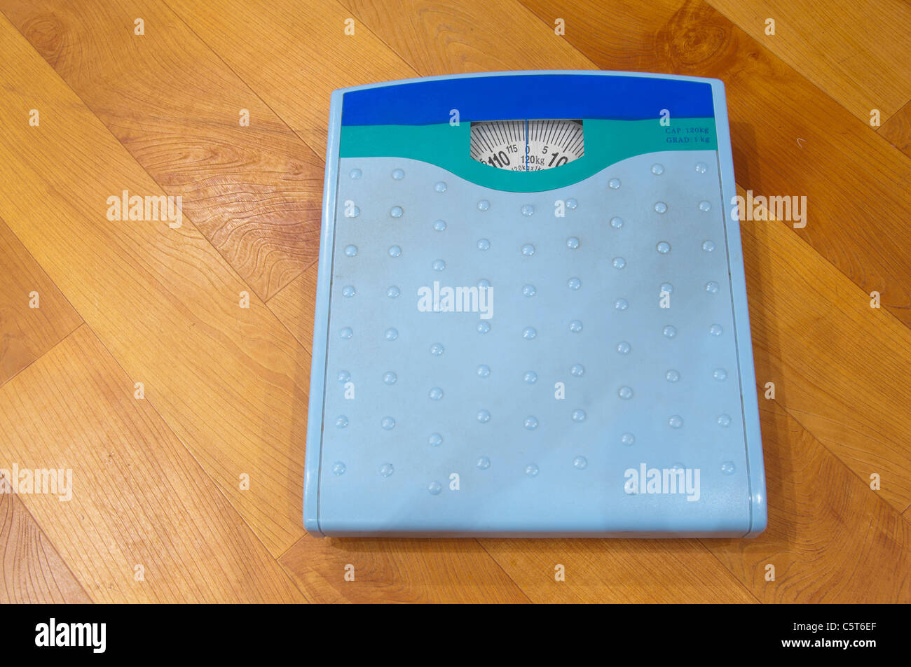 Weighing scales on floor - Stock Image