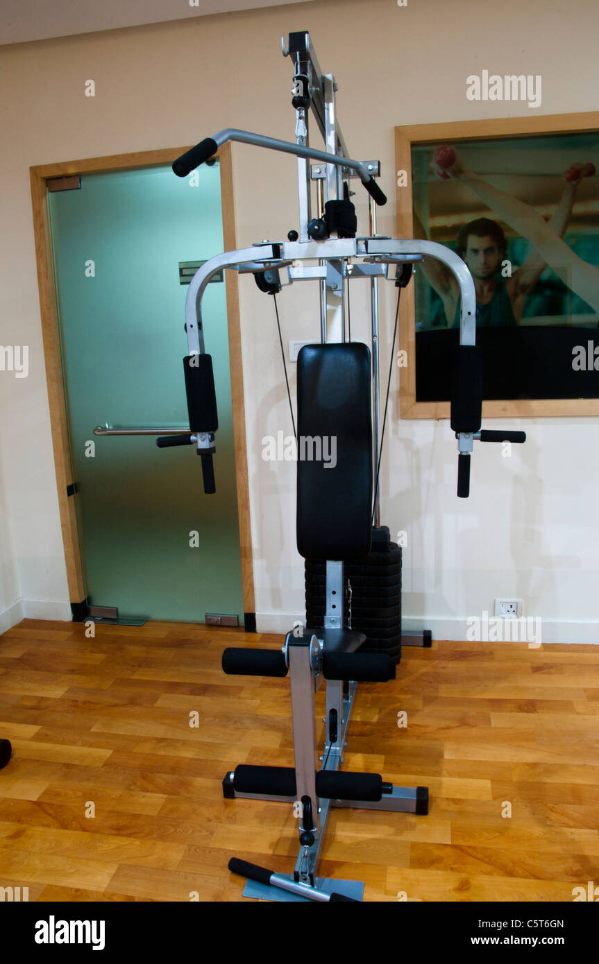 Resistance machine in health club, Gym - Stock Image