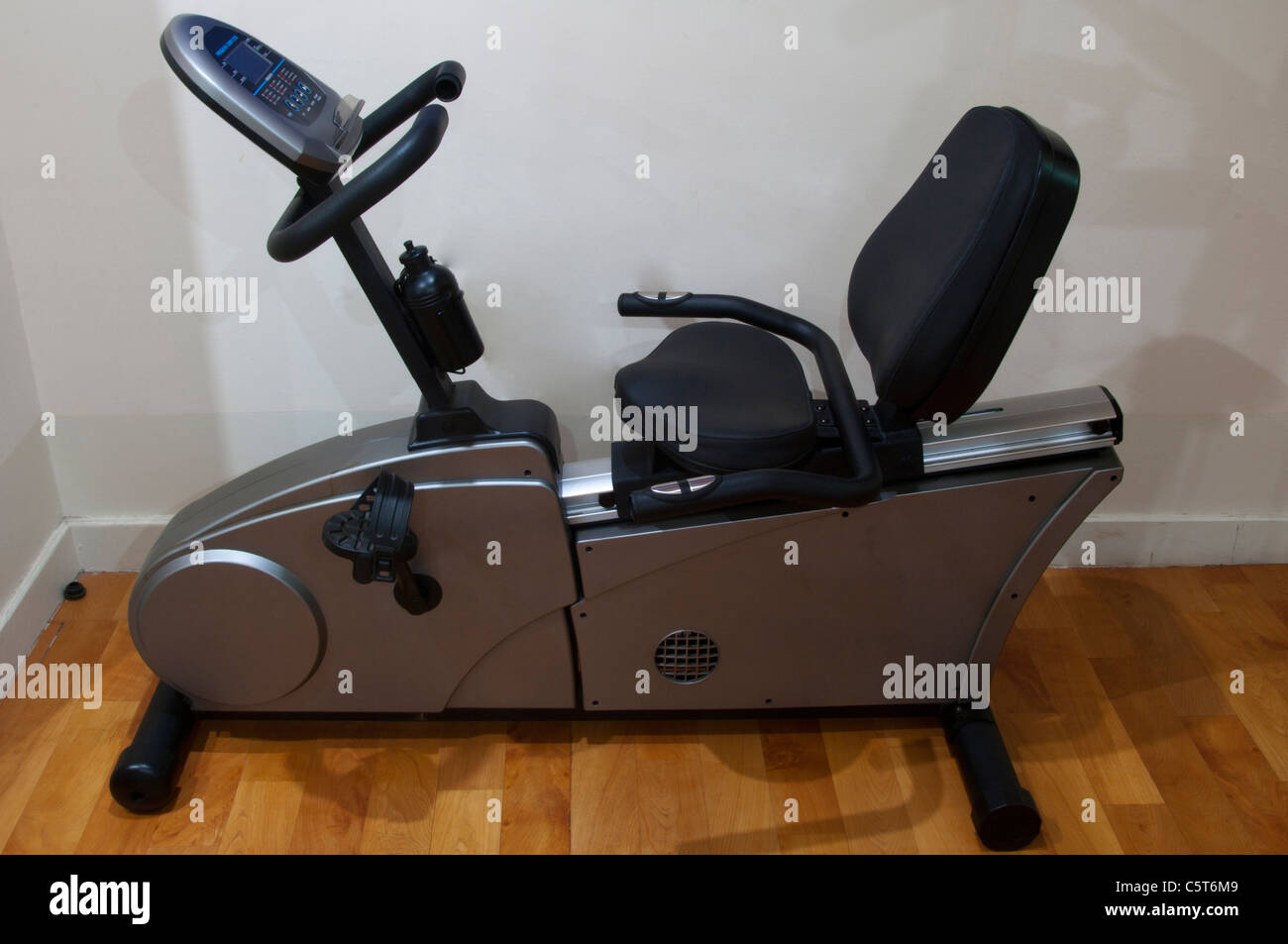 Exercise cycling bike machine in a gym - Stock Image