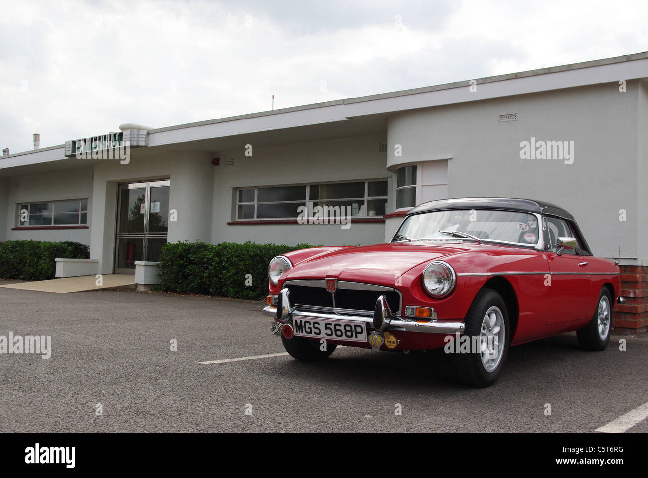 Red MG sports car pictured outside the Aviator hotel at Sywell Aerodrome - Stock Image