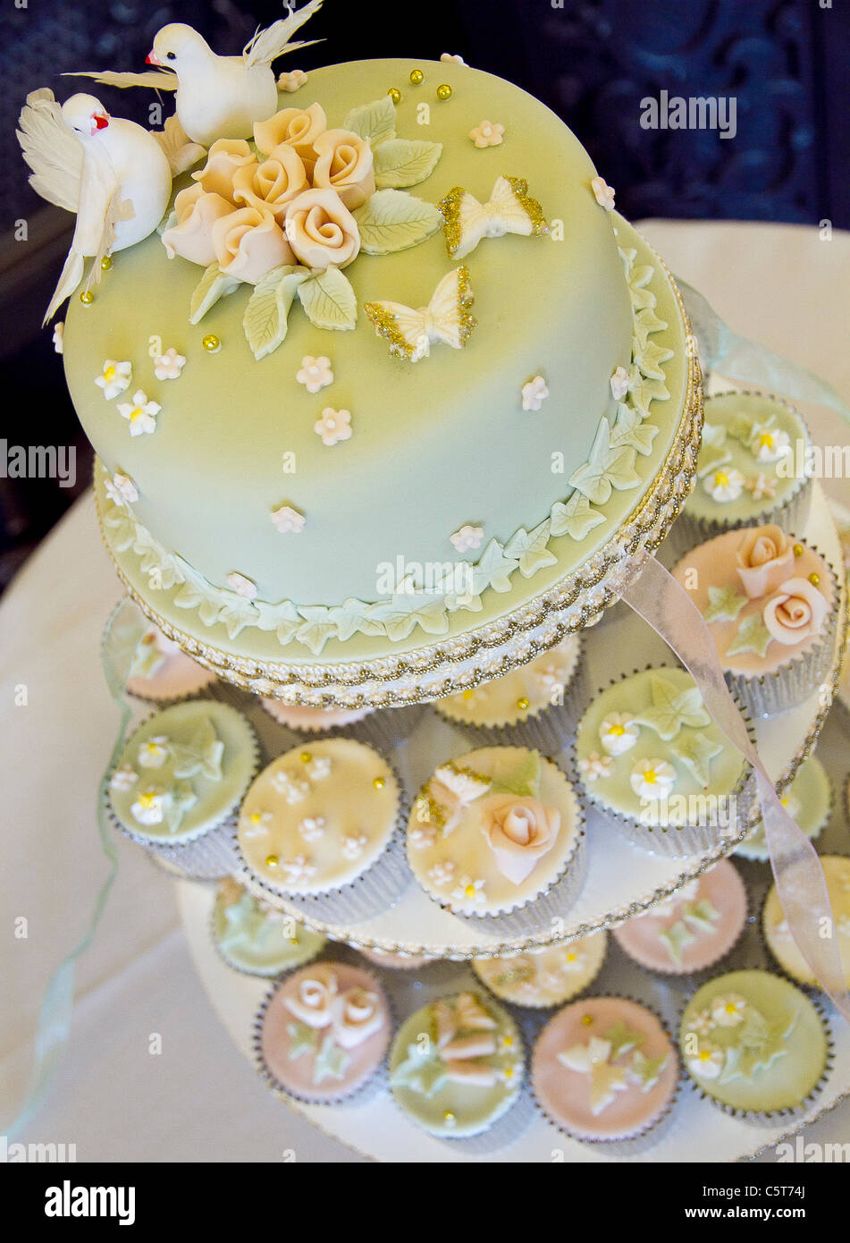 Wedding cake with tiered cup cakes Stock Photo: 38026482 - Alamy