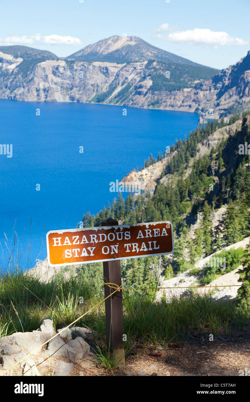 Sign for 'Hazardous area stay on trail' at Crater Lake Oregon USA - Stock Image