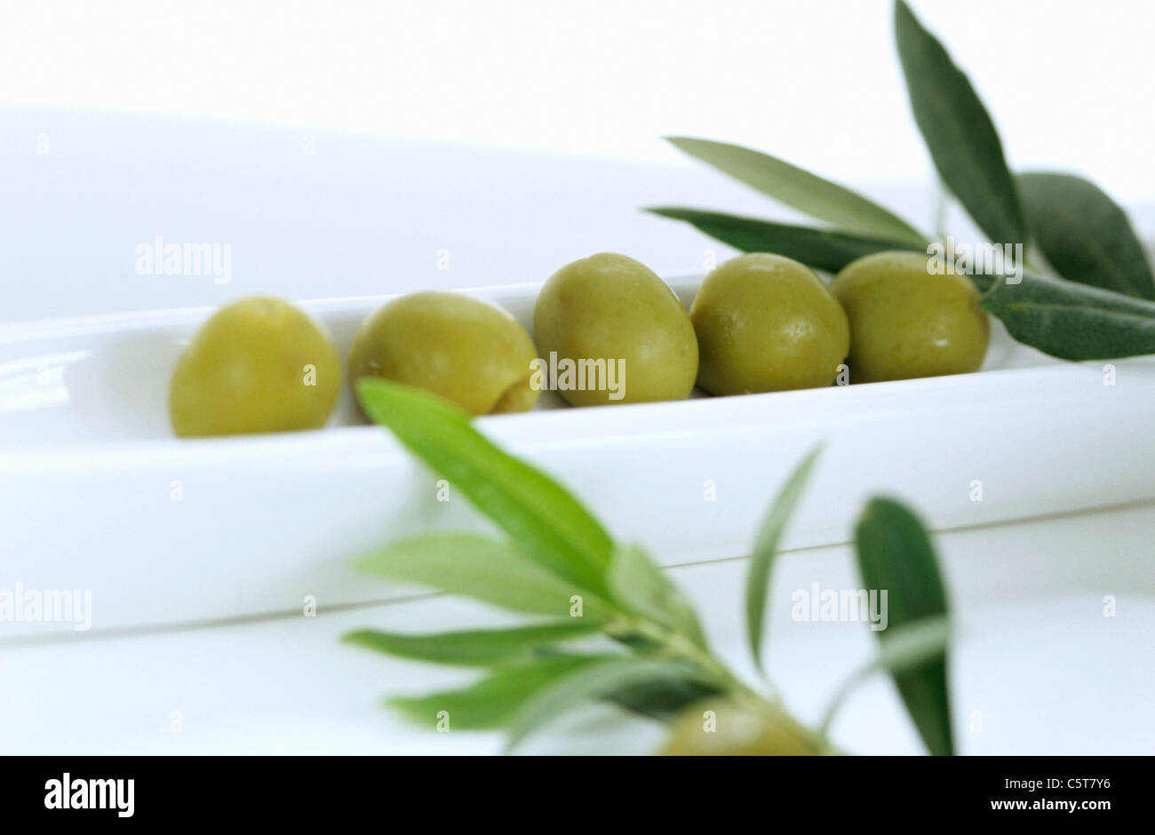 green olives as a starter - Stock Image