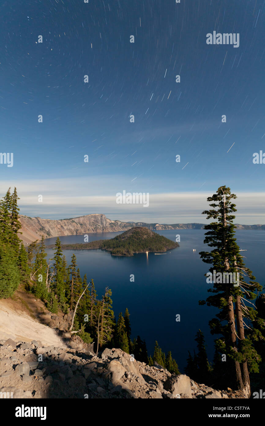 Crater Lake and Wizard Island at night with star trails Oregon USA - Stock Image