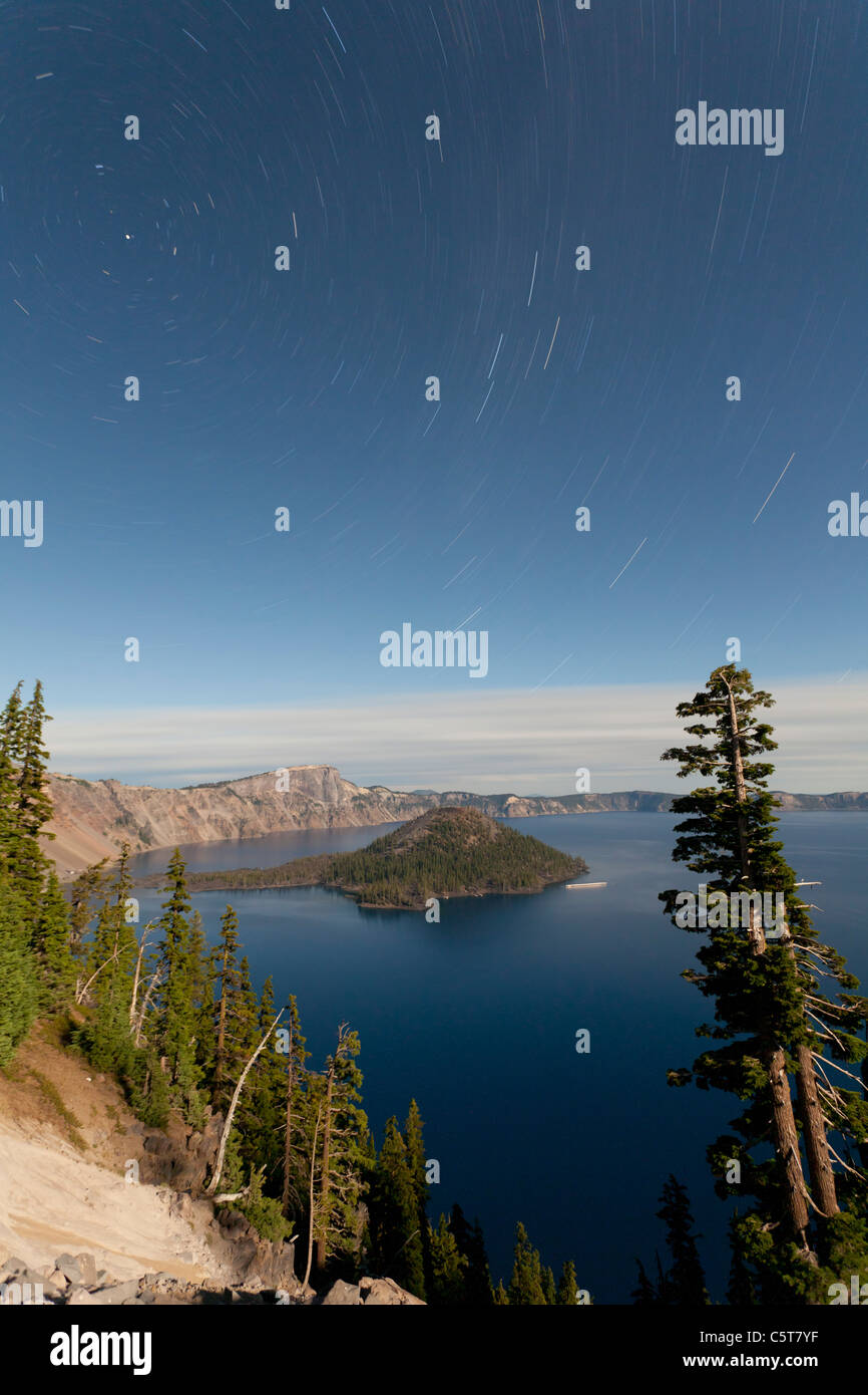 Crater Lake and Wizard Island at night with star trails Oregon USA Stock Photo