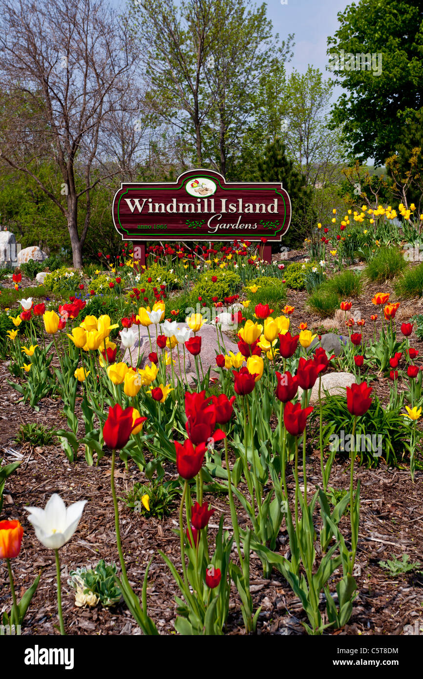 The Windmill Island Sign With Spring Flowers In Holland Michigan