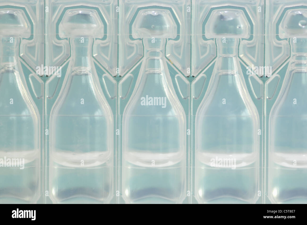 Plastic Vials in a row, full frame, close-up - Stock Image