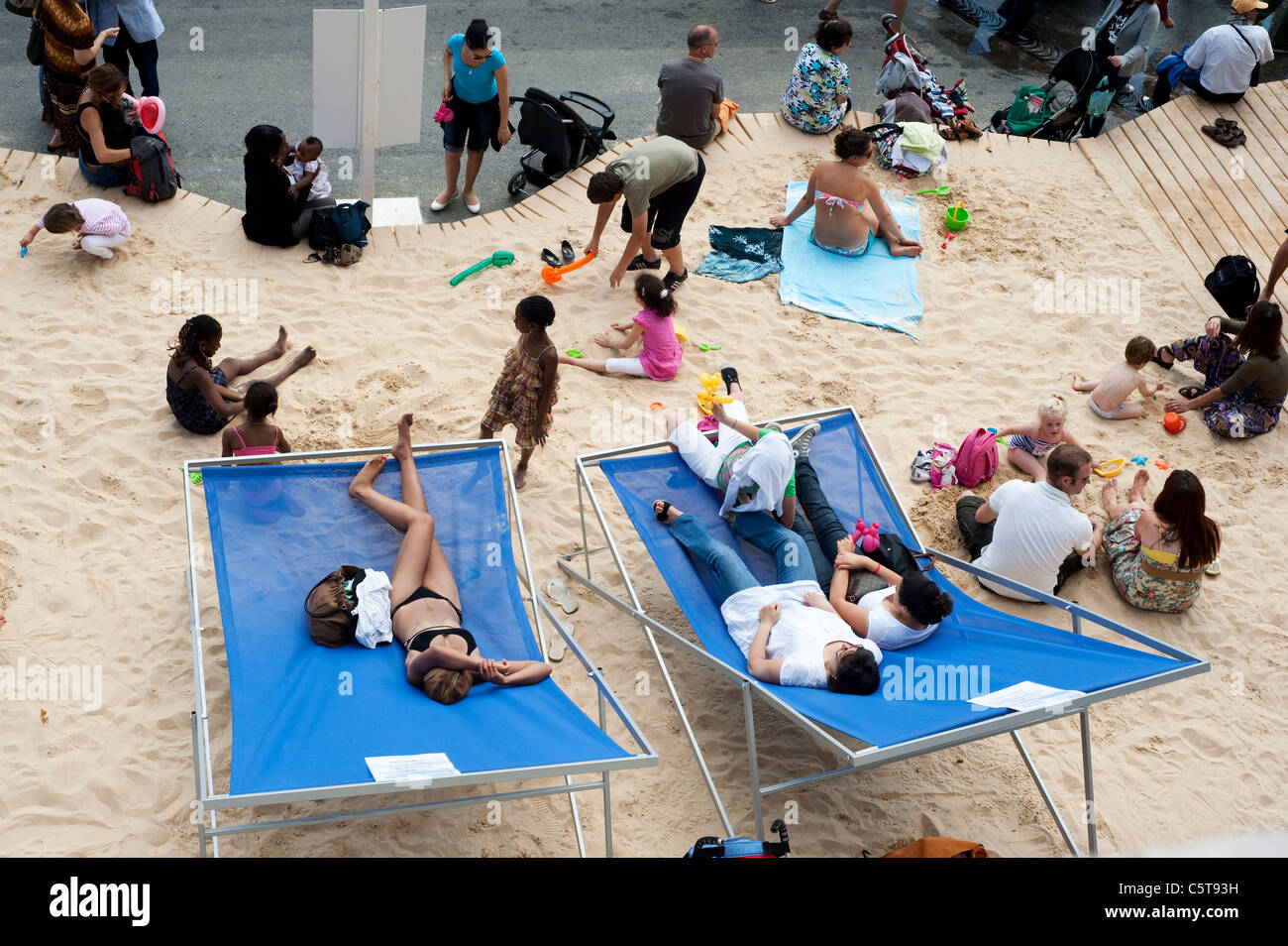 Paris, France Aug 2011 - People enjoying artificial beach during the summer 'Paris Plage' event on the quay - Stock Image