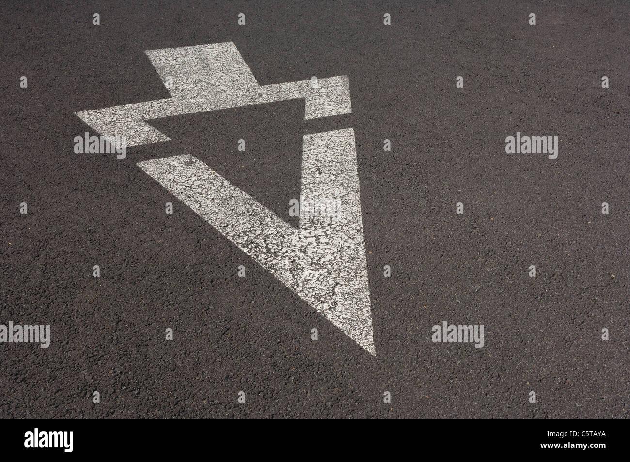 USA, White arrow sign, marking on street - Stock Image