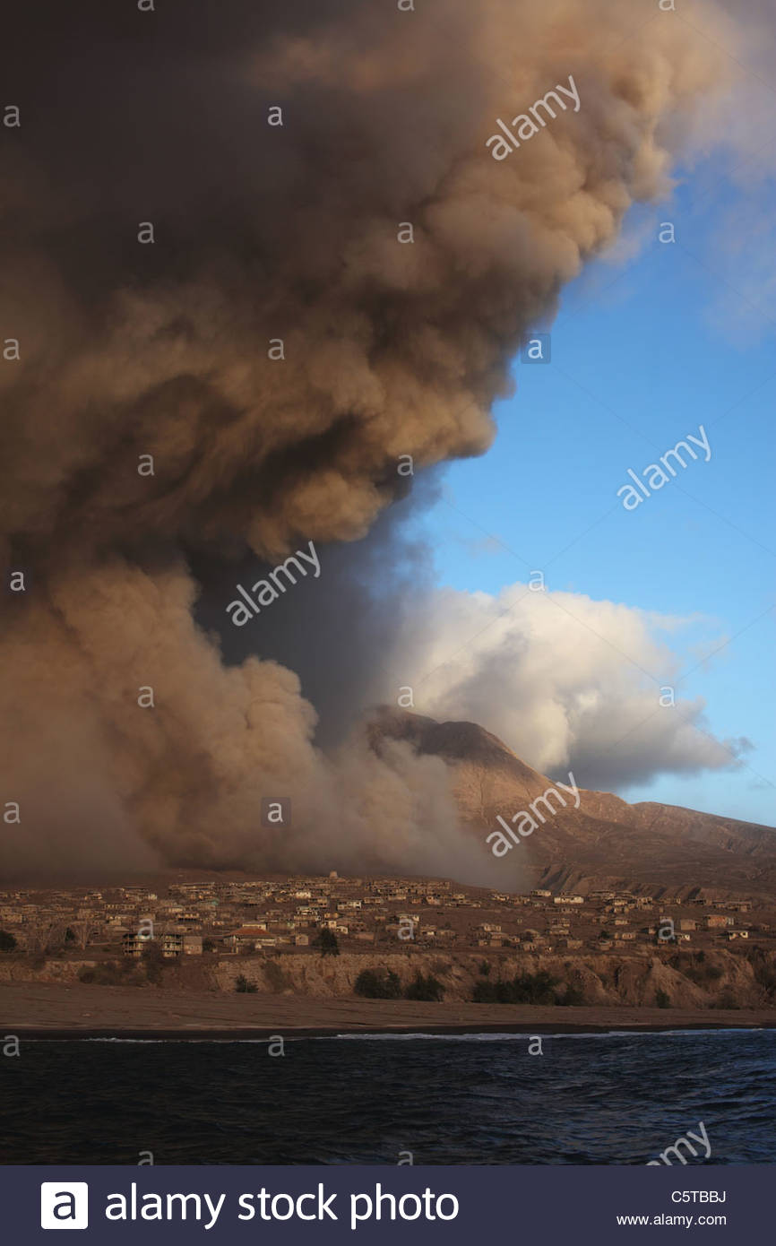 Plymouth, Montserrat, Caribbean, Ash over clouds from eruption - Stock Image