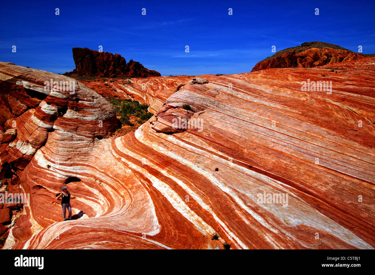Hiker in Valley of Fire, Nevada, USA - Stock Image