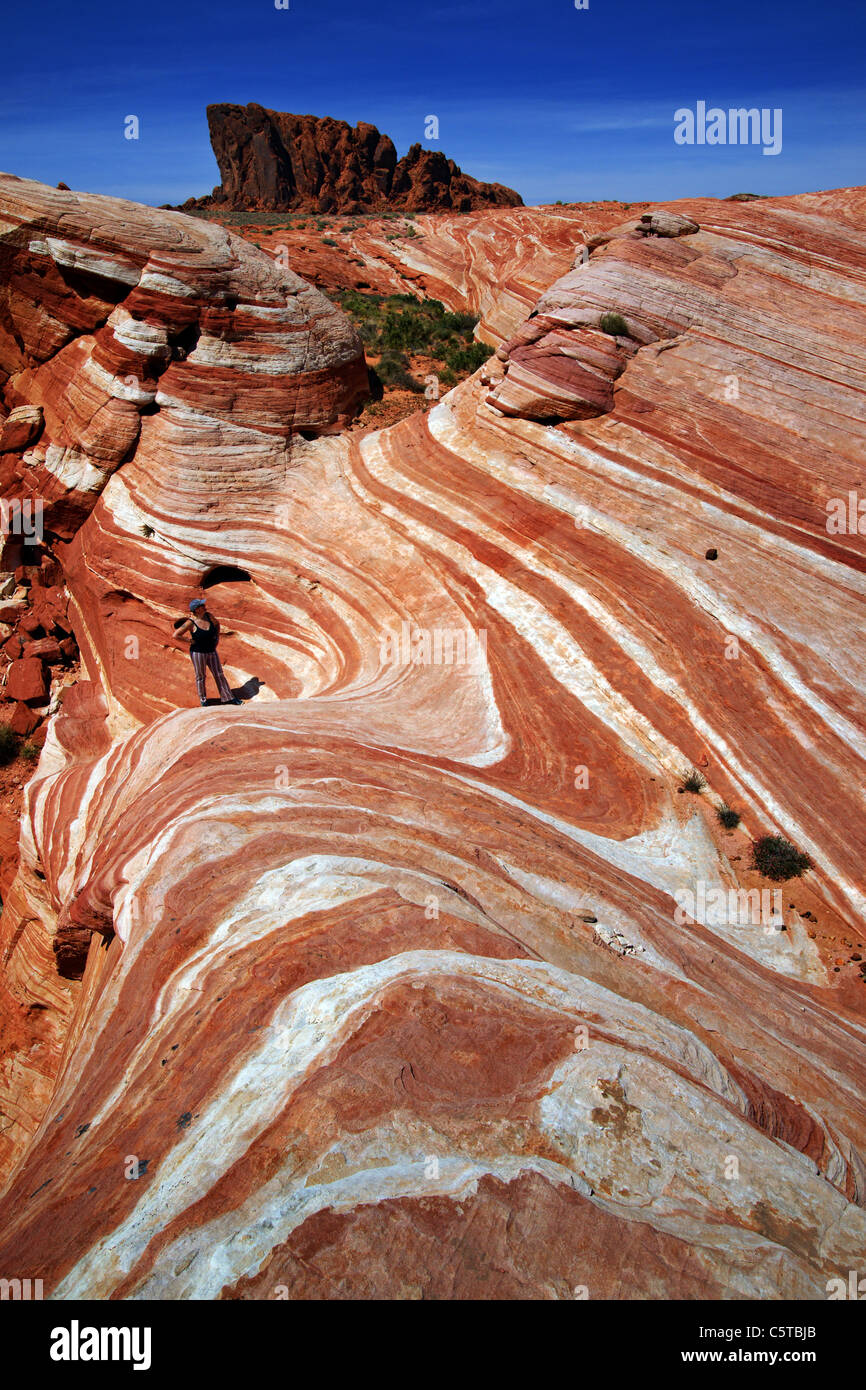 Woman hiker standing in Valley of Fire, Nevada, USA - Stock Image