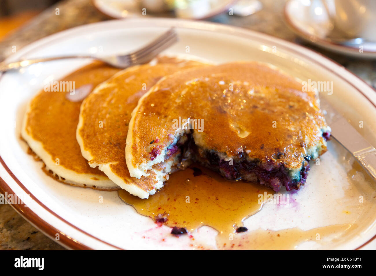 Blueberry pancakes and maple syrup in cafe in New York City Stock Photo