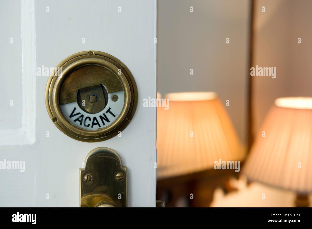 Antique brass bathroom door lock and