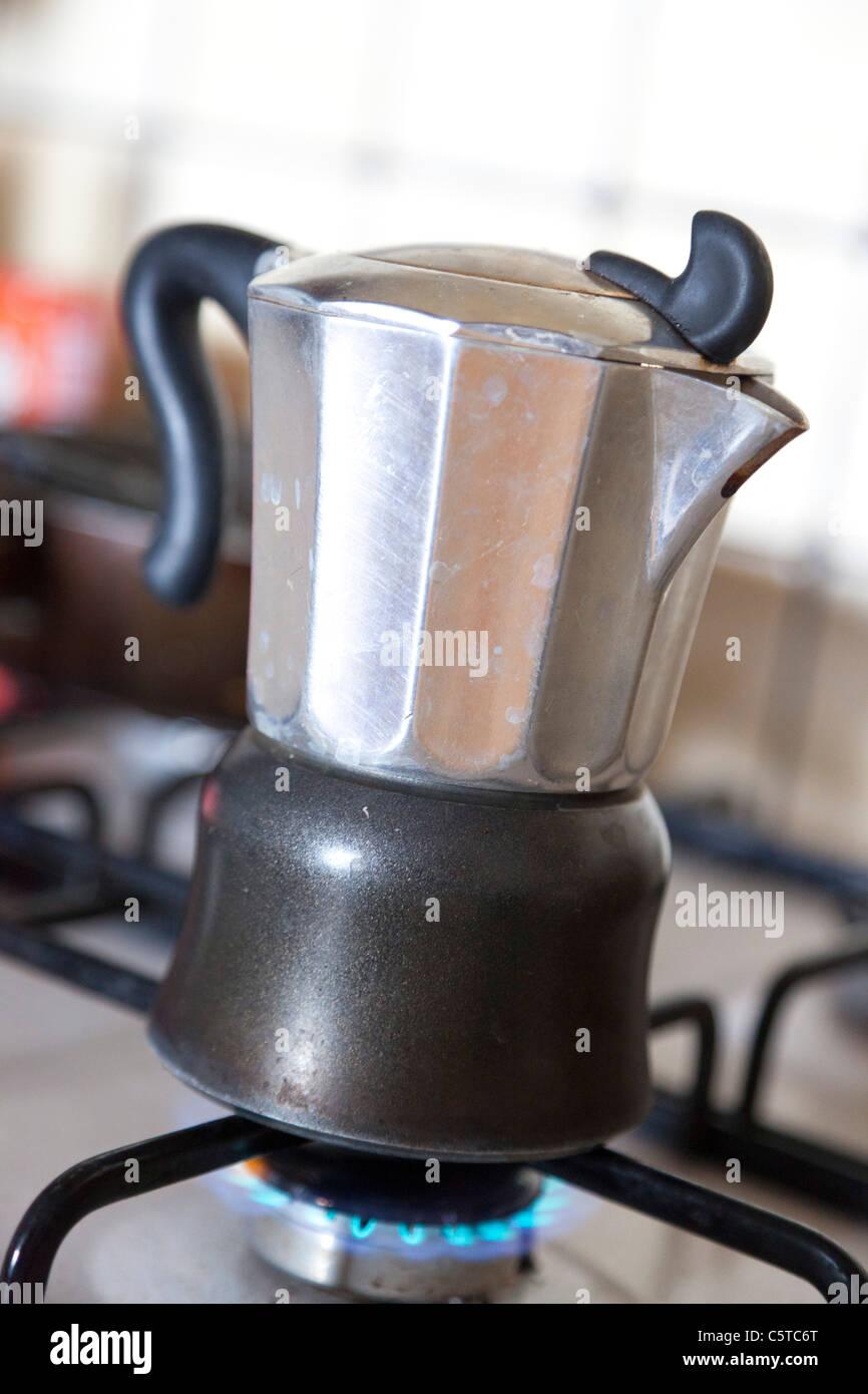 moka coffee pot on gass stove - Stock Image