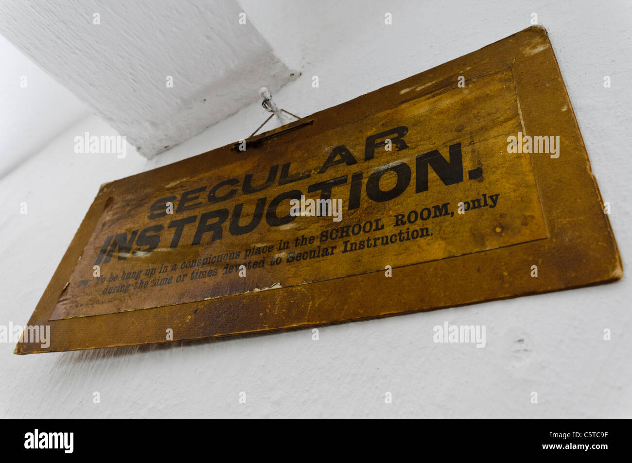 Sign saying 'Secular Instruction' in a Victorian classroom - Stock Image