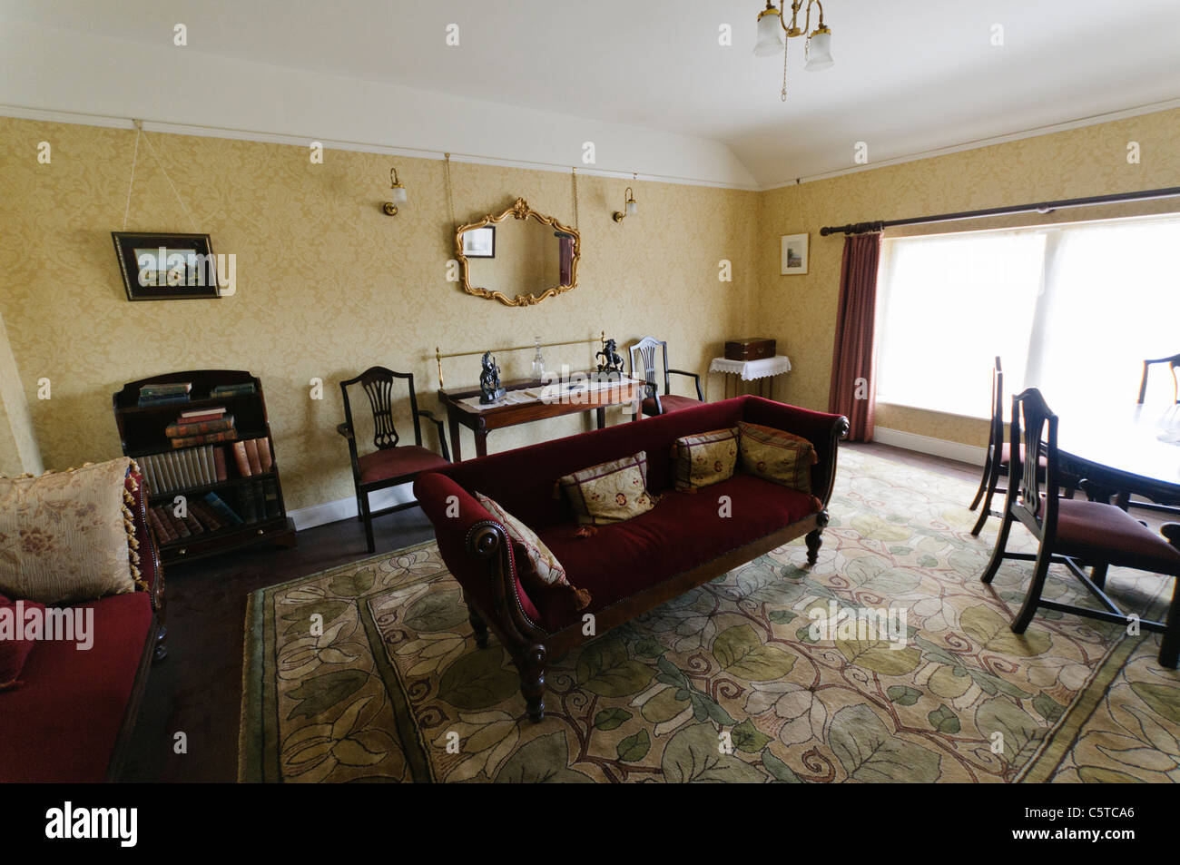 Old fashioned drawing room in a Victorian home at the Ulster Folk Park Museum - Stock Image