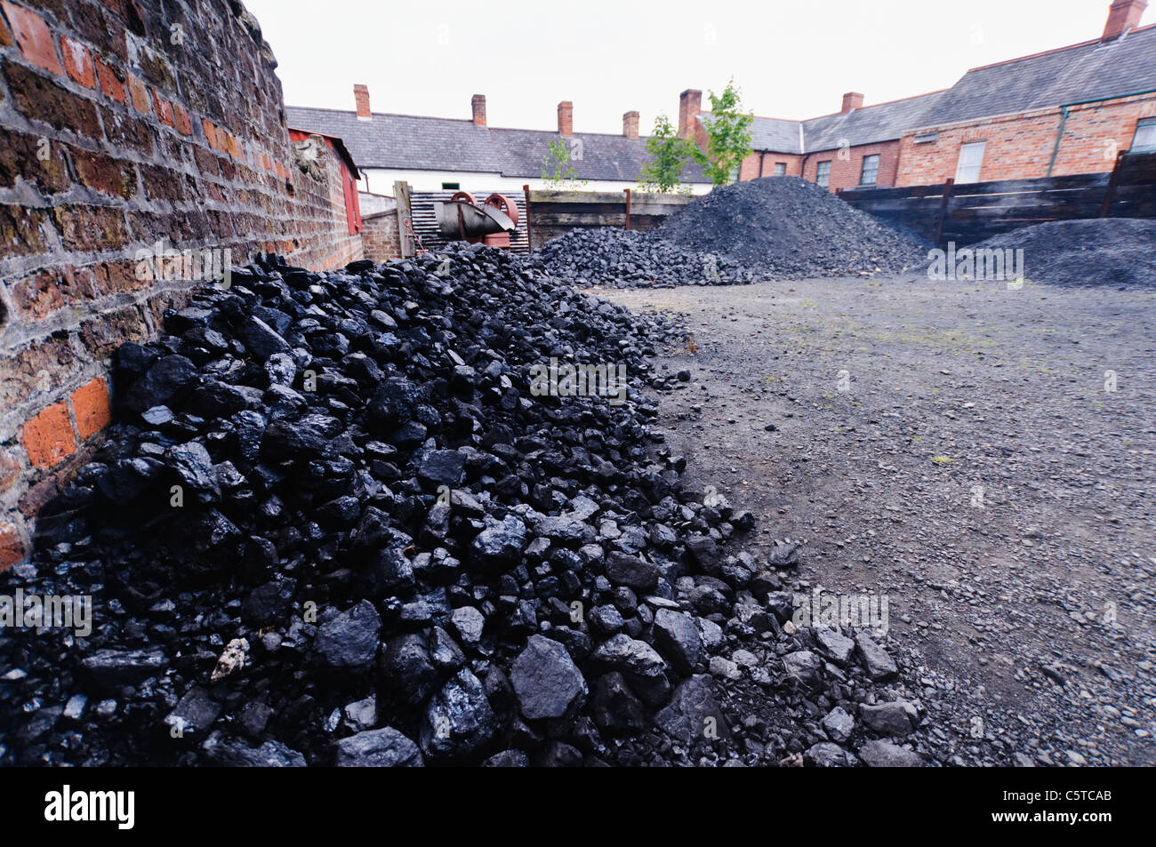 Piles of coal at a coal yard - Stock Image