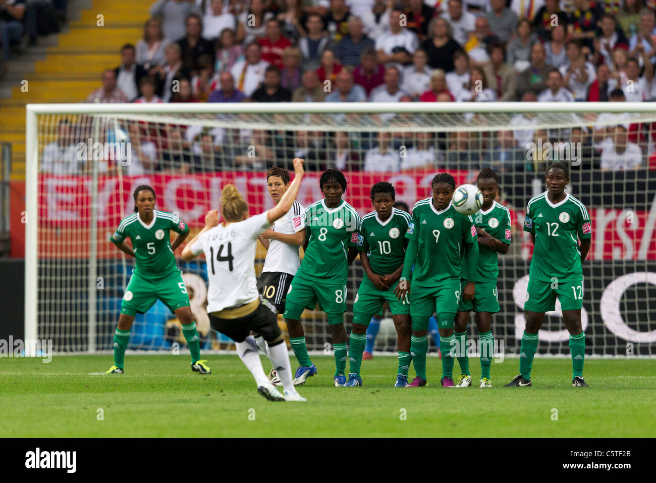 Kim Kulig of Germany (14) takes a free kick against a Nigerian defensive wall during a 2011 FIFA Women's World - Stock Image