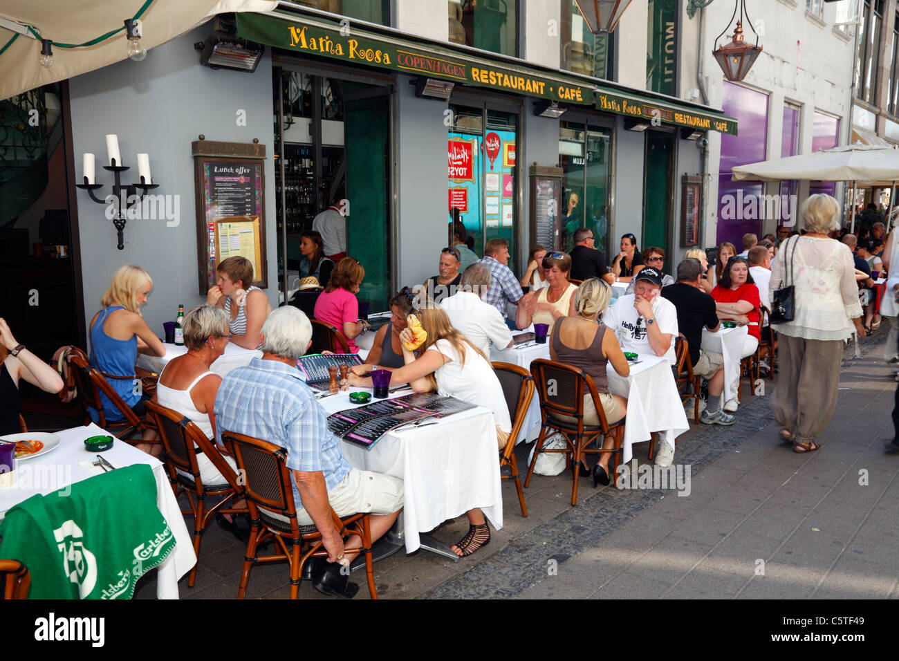 The cafe and restaurant Mama Rosa on Strøget in Copenhagen, Denmark, on a warm and busy summer day in the tourist - Stock Image