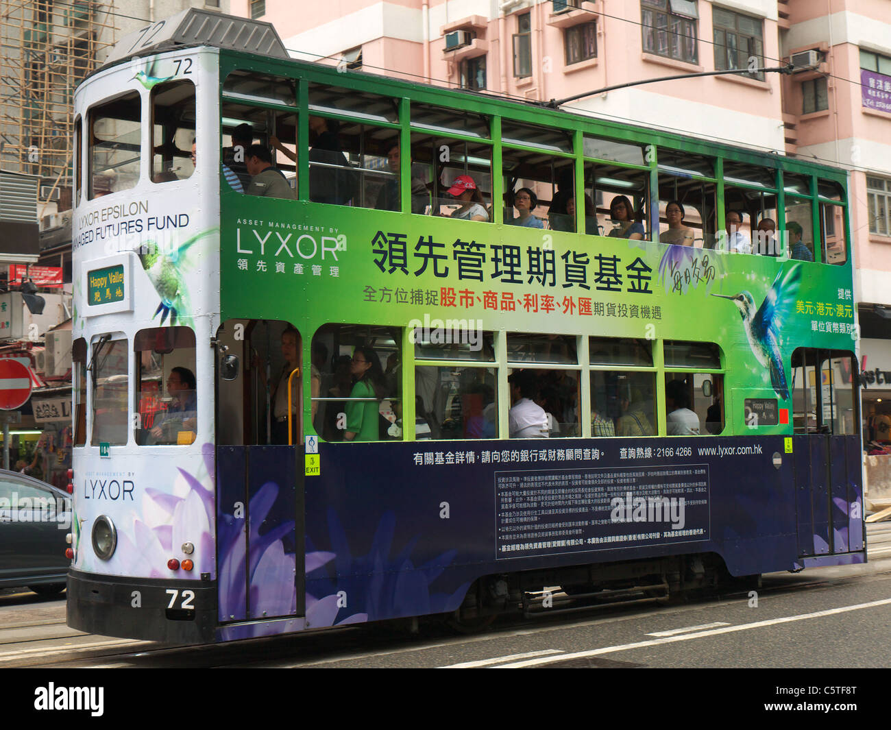 Side view of a tram moving through Hong Kong - Stock Image