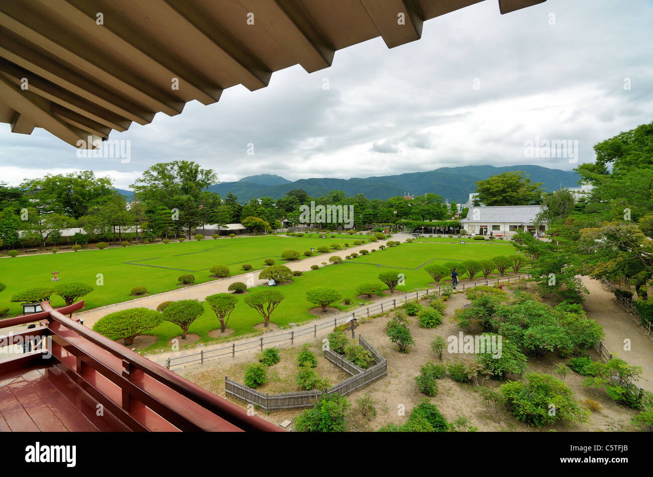 Matsumoto castle grounds viewed from an upper-level veranda in Nagano prefecture, Japan. - Stock Image