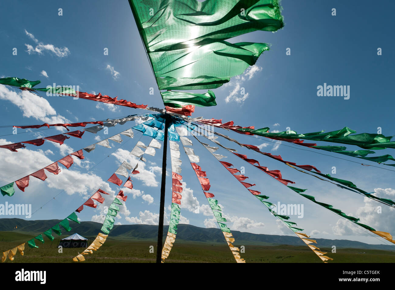 Tibetan Buddhist prayer flags flutter at folk festival, Haibei, Qinghai Province, China Stock Photo