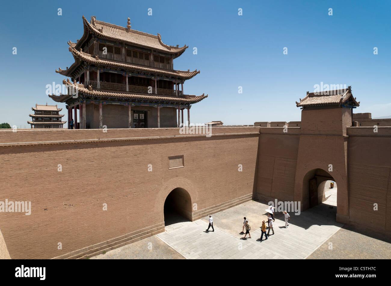 Rammed earth walls tower above courtyard at Jiayuguan Fort, part of Great Wall of China, Jiayuguan, Gansu Province, - Stock Image