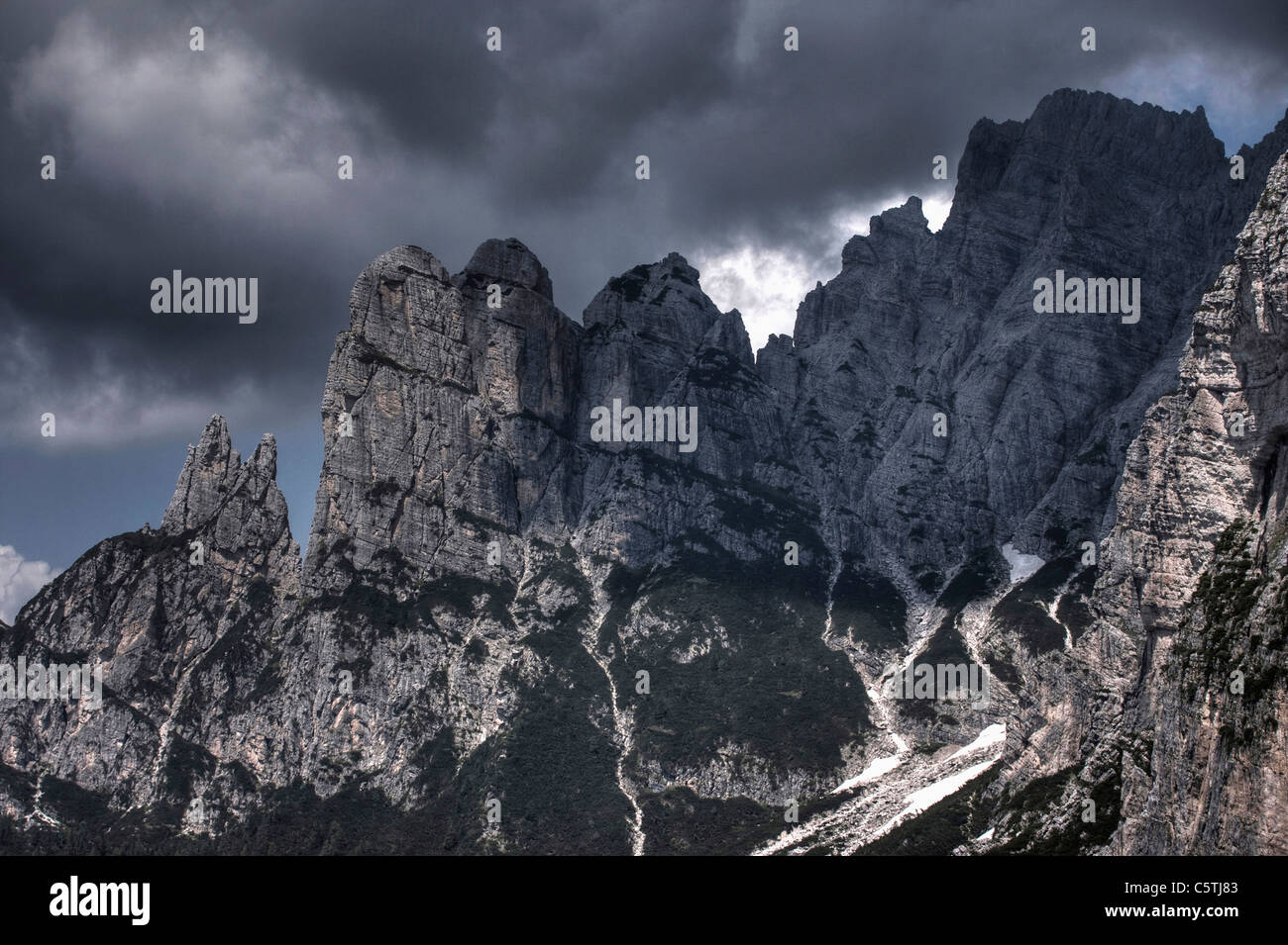 Italy, Dolomites, Rock face, Stormy atmosphere - Stock Image